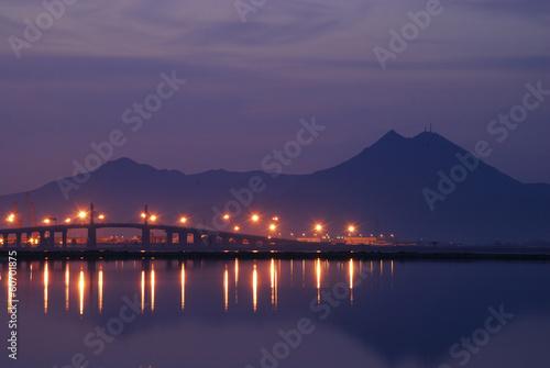 Bridge and light at Tunis lake at dawn