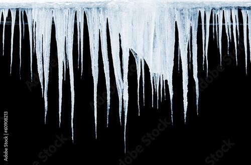 Obraz na płótnie Group of icicles hanging on black background