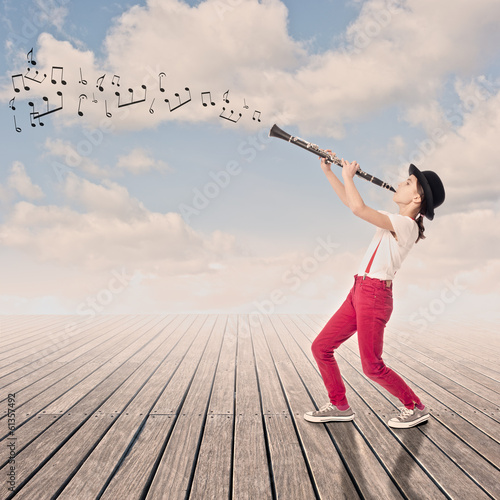 Leinwand Poster little girl playing clarinet