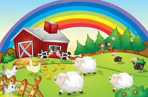 A farm with many animals and a rainbow in the sky