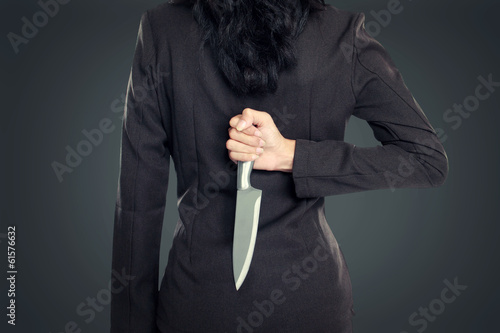Business woman Holding Knife Behind His Back Fototapeta