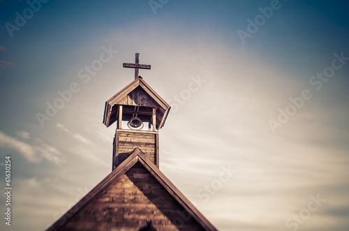 Canvas Rural old church steeple cross and bell tower