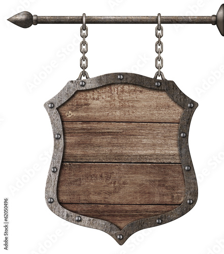 Fotografia medieval wood sign or shield hanging on chains isolated on white