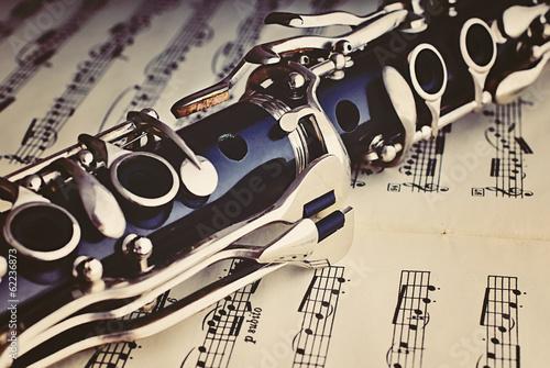 Fotografie, Obraz Klarinette auf einem Notenblatt