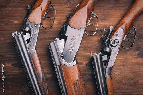 Shotgun  on wooden background Fototapeta