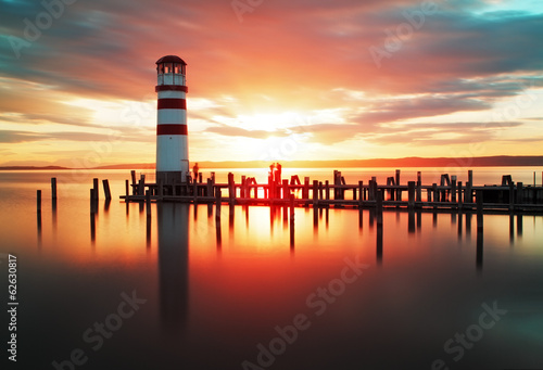Canvas Print Beach sunrise with lighthouse
