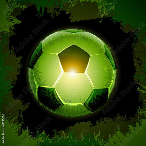 green grass soccer ball black
