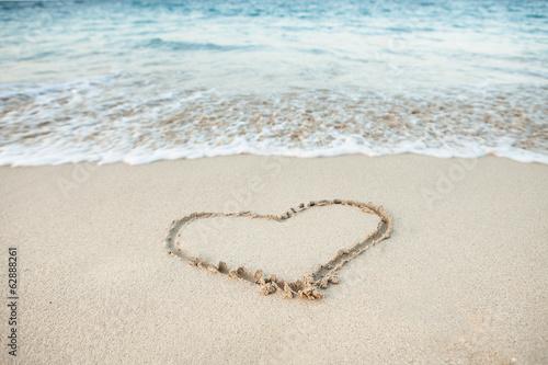Heart shape drawn in sand
