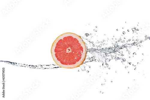 Slice of grapefruit in water splash