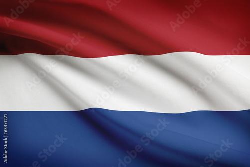 Wallpaper Mural Series of ruffled flags. Netherlands.