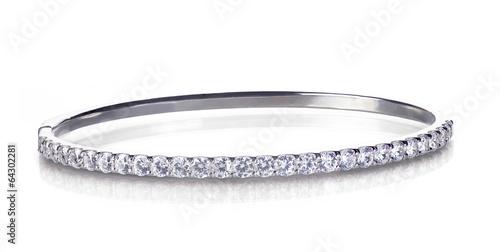 Fotografía Diamond and gold bangle bracelet isolated on white