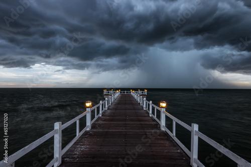 Wooden bridge into the sea