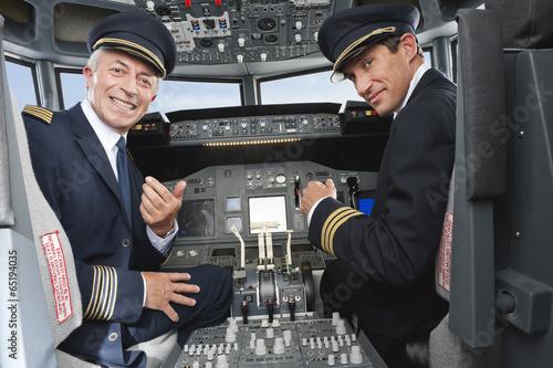 Slika na platnu Deutschland,Bayern,München,Pilot und Co-Pilot Pilotierung Flugzeug von Flugzeug-
