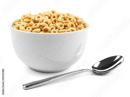 Canvas Print Bowl of oat cereal with spoon on white background