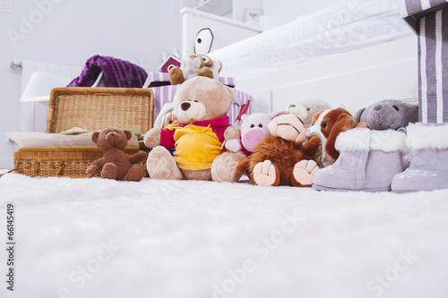 Stuffed animal toys in interior room