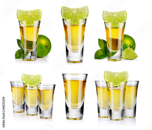 Fotografia Set of gold tequila shot with lime fruits isolated