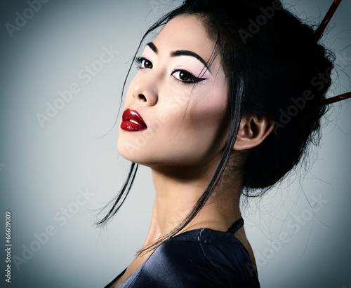 Valokuva Young beautiful asian woman's portrait, studio shot toned