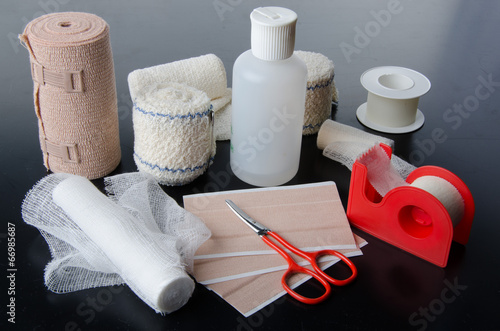 Tablou Canvas Different rolls of medical bandages and care equipment