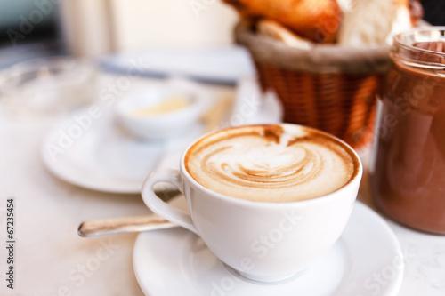 Obraz na płótnie cappuccino with croissants