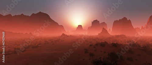 Fotografering Red rocky desert landscape in the mist at sunset. Panoramic shot
