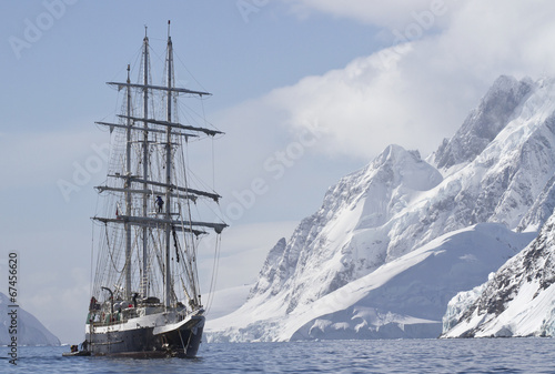 tourist ship sailing summer day on a background of mountain peak