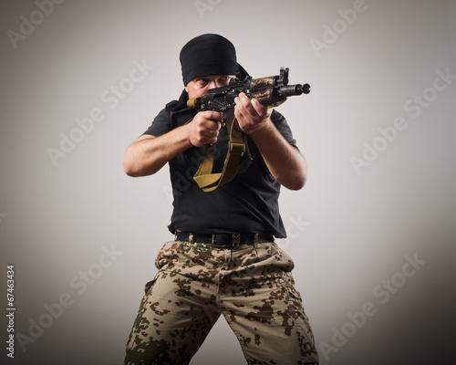 Wallpaper Mural Man with gun