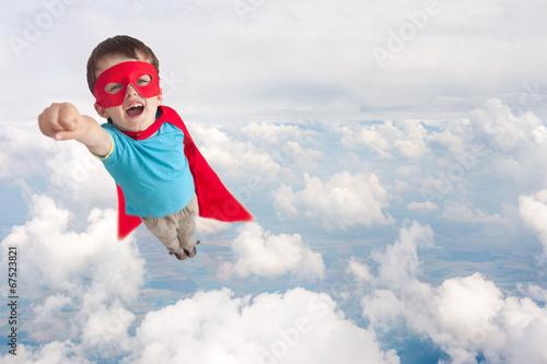 Valokuvatapetti superhero child boy flying
