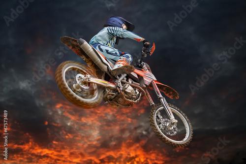 Canvas Print Flying motocross rider fire storm