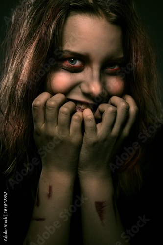 Fotografia Girl possessed by a demon with a sinister smile