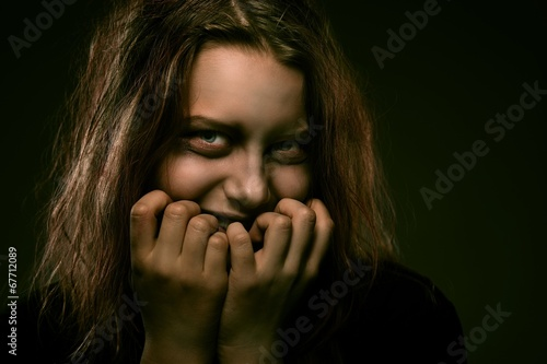 Valokuva Girl possessed by a demon with a sinister smile