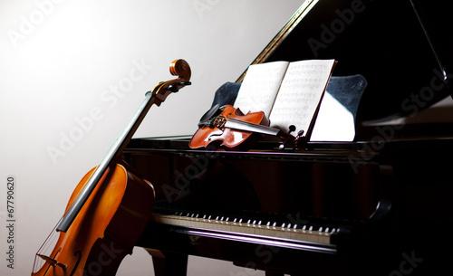 Photo Classical music concept: cello, violin, piano and a score