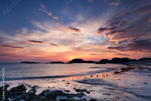 Fototapeta Dramatic sky at sunset on the Isle of Iona, Scotland
