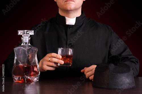 priest drinking alcohol Fototapeta
