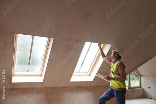 Building Inspector Looking At New Property Fototapeta