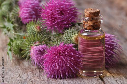 Fényképezés Oil of burdock close-up on a table