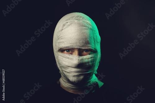 Obraz na płótnie Infected sick girl with a bandage on her head