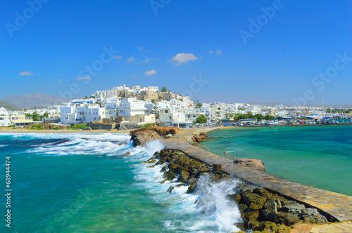 Платно Waves breaking on Naxos town pier, Greece