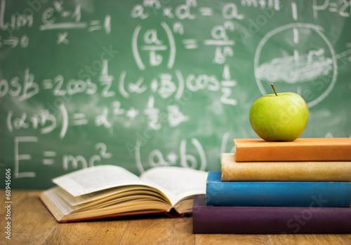 Photo School books with apple on desk
