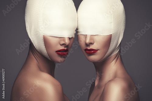 Two beauty woman with bandage Fototapeta