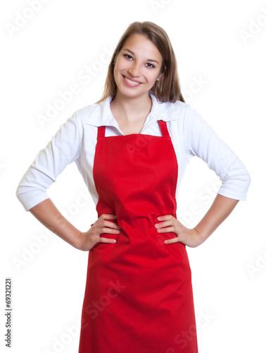 Fotografia Lachende Frau mit roter Schürze