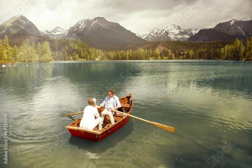 Stampa su Tela Senior couple on boat