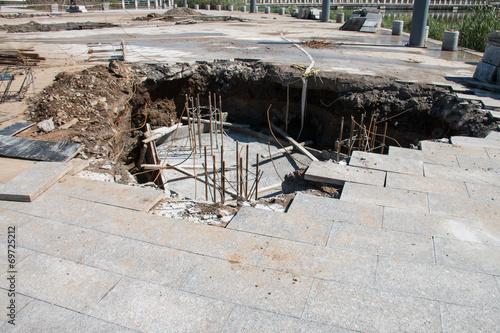 Fototapeta Sinkhole in Sidewalk