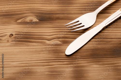 Vászonkép Knife and fork set on a wooden vintage table