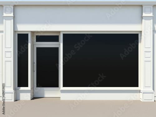 Fotografia Shopfront with large windows. White store facade.