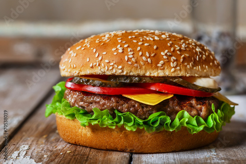 Fotografie, Tablou hamburger with cutlet grilled on a wooden surface