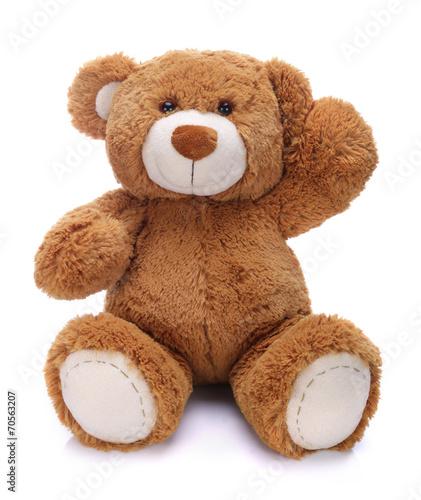 Sweet teddy bear waving his paw