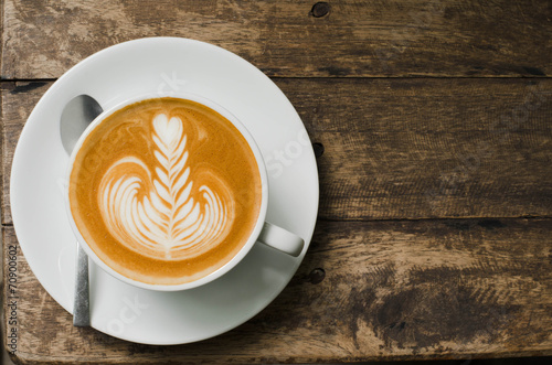 classic foamy cappuccino on dark grained wood table from above Fototapet