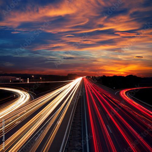 Speed Traffic at Dramatic Sundown Time - light trails