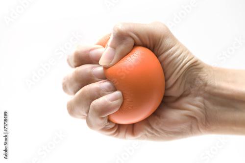 Fotografia Hand squeezing a stress ball