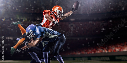 Wallpaper Mural American football player in action at game time